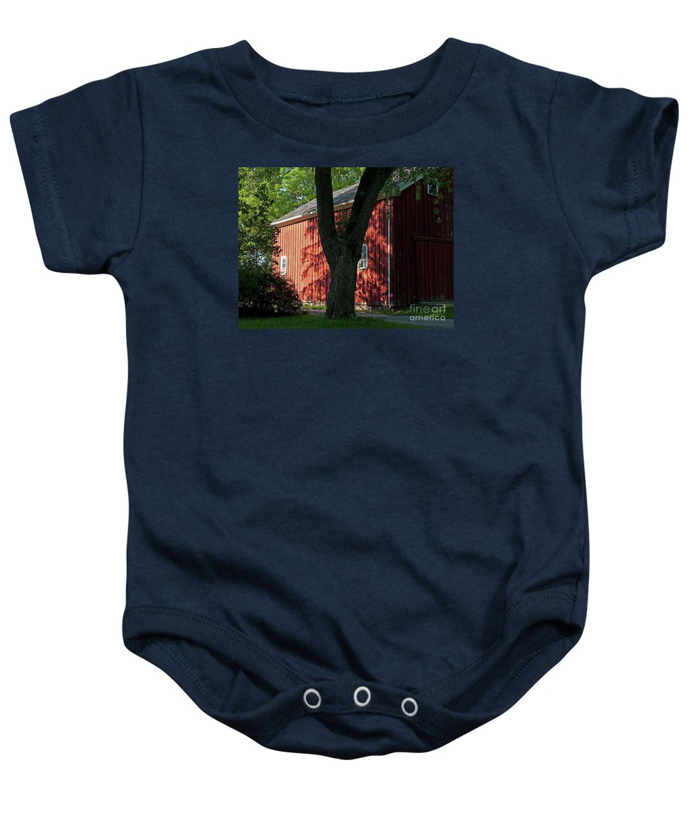 Barn Baby Onesie featuring the photograph Fiery Shadows by Ann Horn