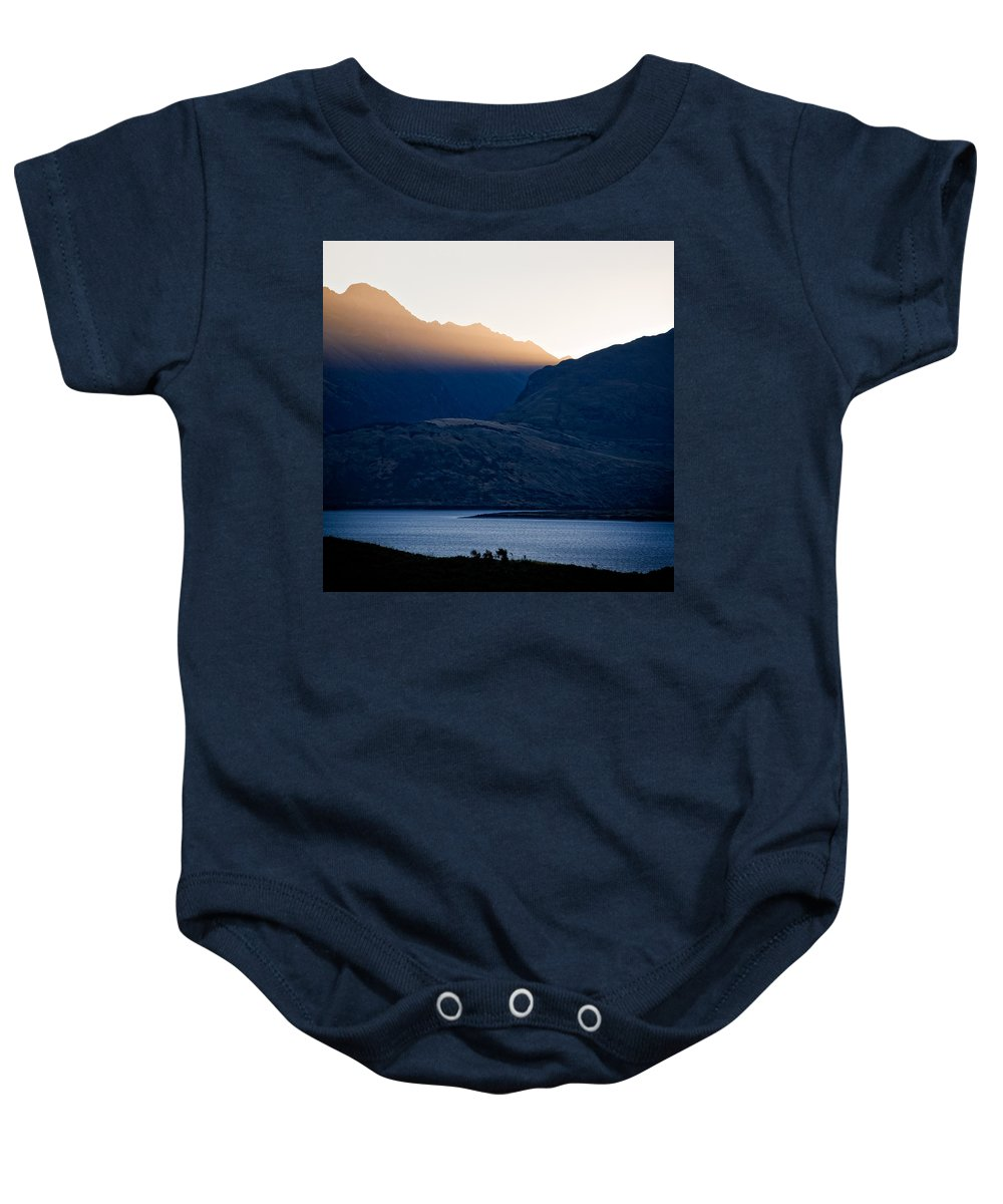 New Zealand Baby Onesie featuring the photograph Golden Rays by Dave Bowman