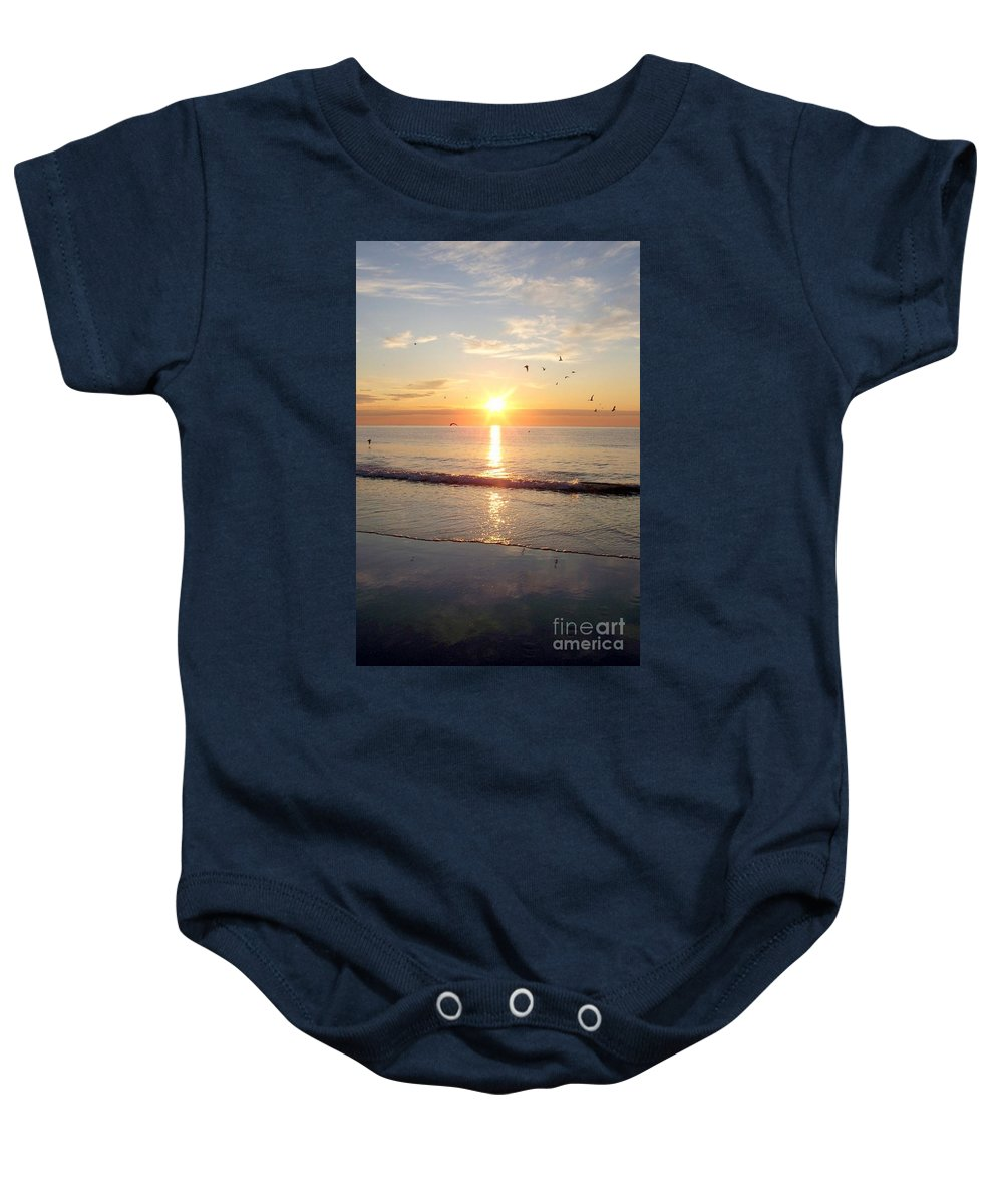 Seascape Baby Onesie featuring the photograph Gulls Dance In The Warmth Of The New Day by Eunice Miller