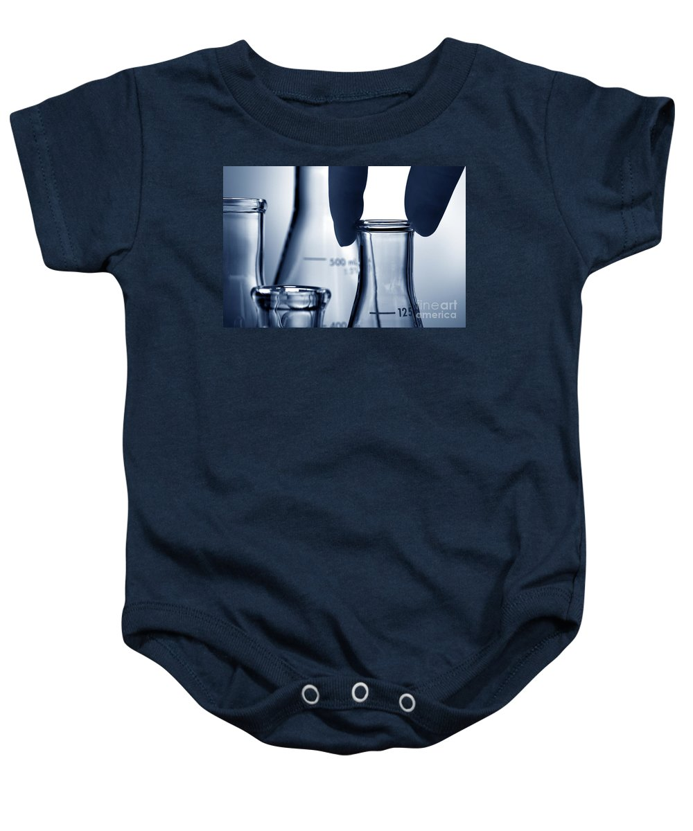 Flask Baby Onesie featuring the photograph Laboratory Erlenmeyer Flasks In Science Research Lab by Science Research Lab By Olivier Le Queinec