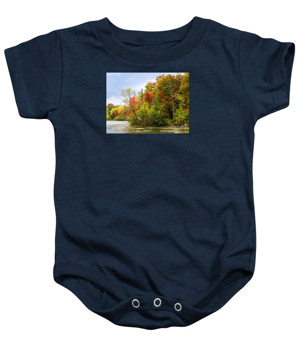 Autumn Baby Onesie featuring the photograph Leaning Into Autumn by Ann Horn