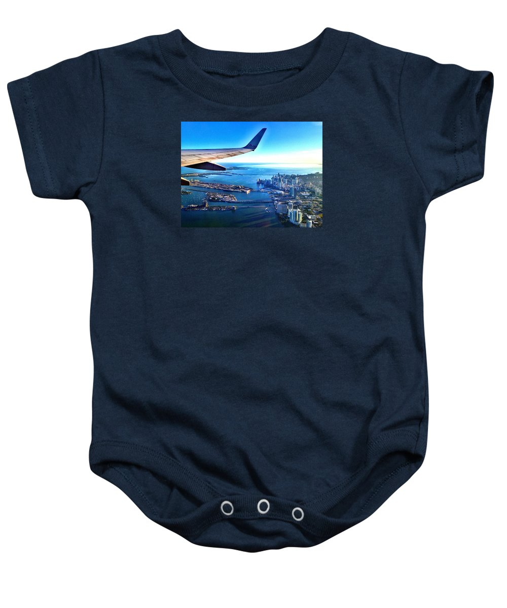 Airplane Baby Onesie featuring the photograph Plane Over Miami by Gilda Parente