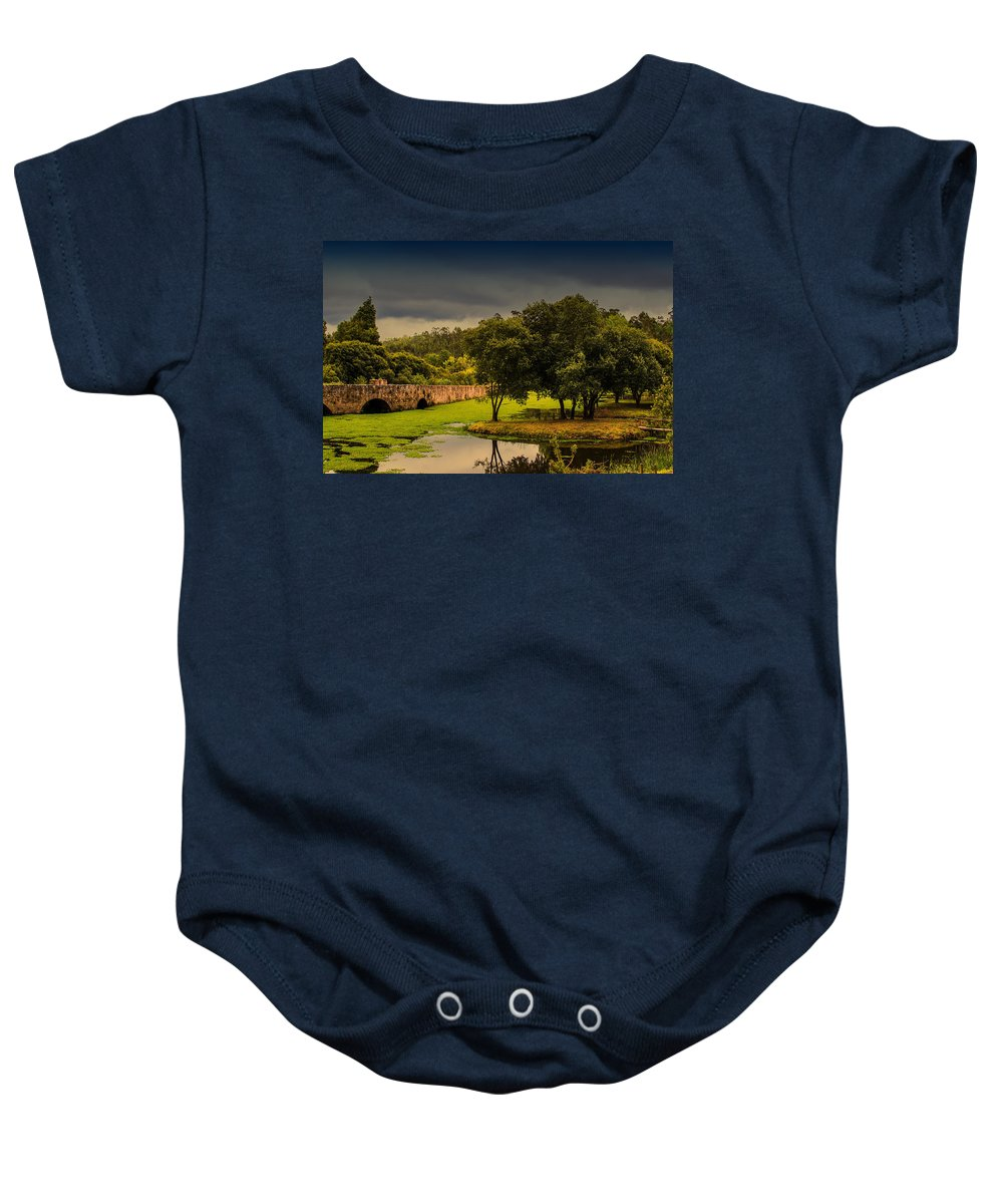 Roman Bridge By The Lake Baby Onesie featuring the photograph Roman Bridge By The Lake by Marco Oliveira