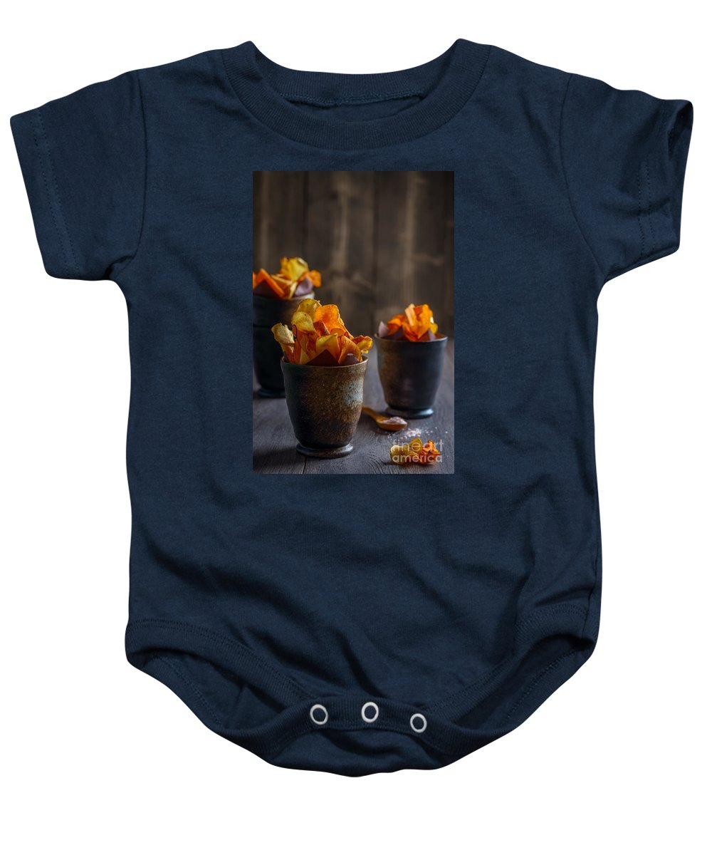 Crisps Baby Onesie featuring the photograph Root Vegetable Crisps by Amanda Elwell