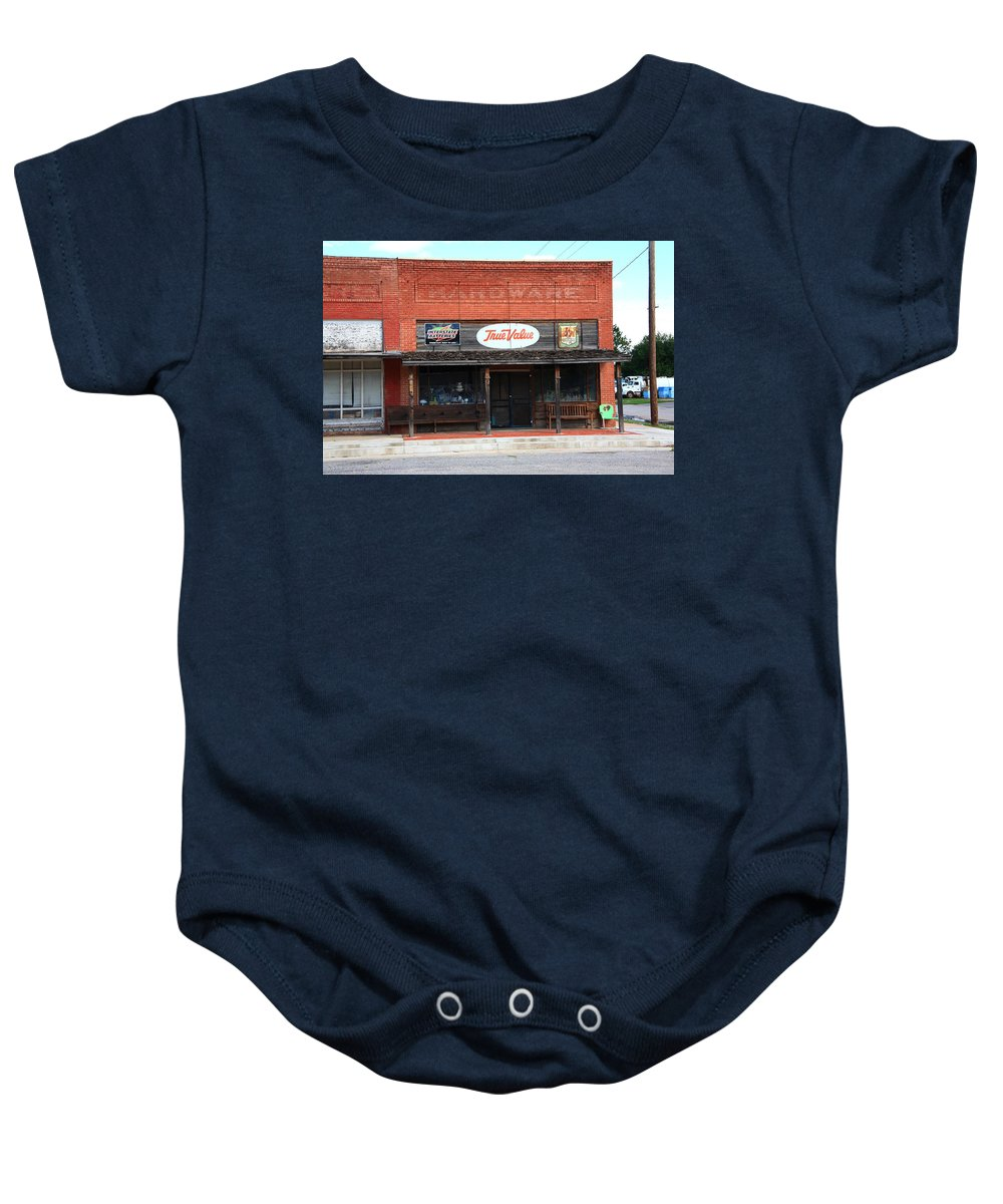 66 Baby Onesie featuring the photograph Route 66 - Hardware Store Erick Oklahoma by Frank Romeo