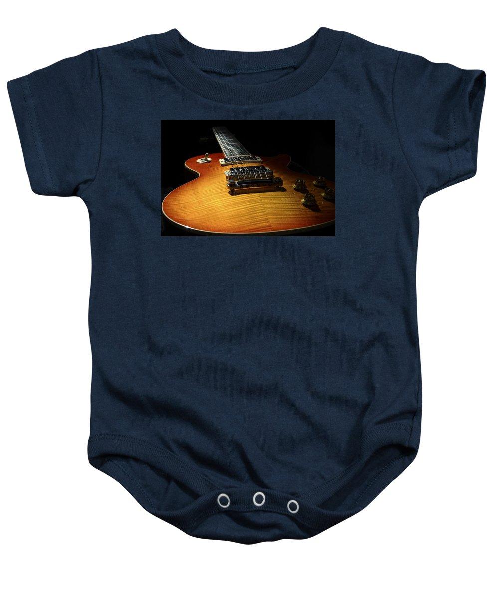 Gibson Baby Onesie featuring the photograph Sunburst Les Paul by John Clark