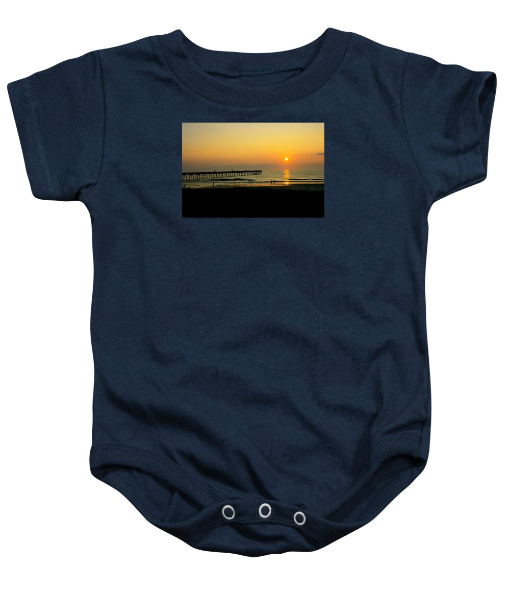 Ocean Baby Onesie featuring the photograph Surfers Sunrise by Susan McMenamin