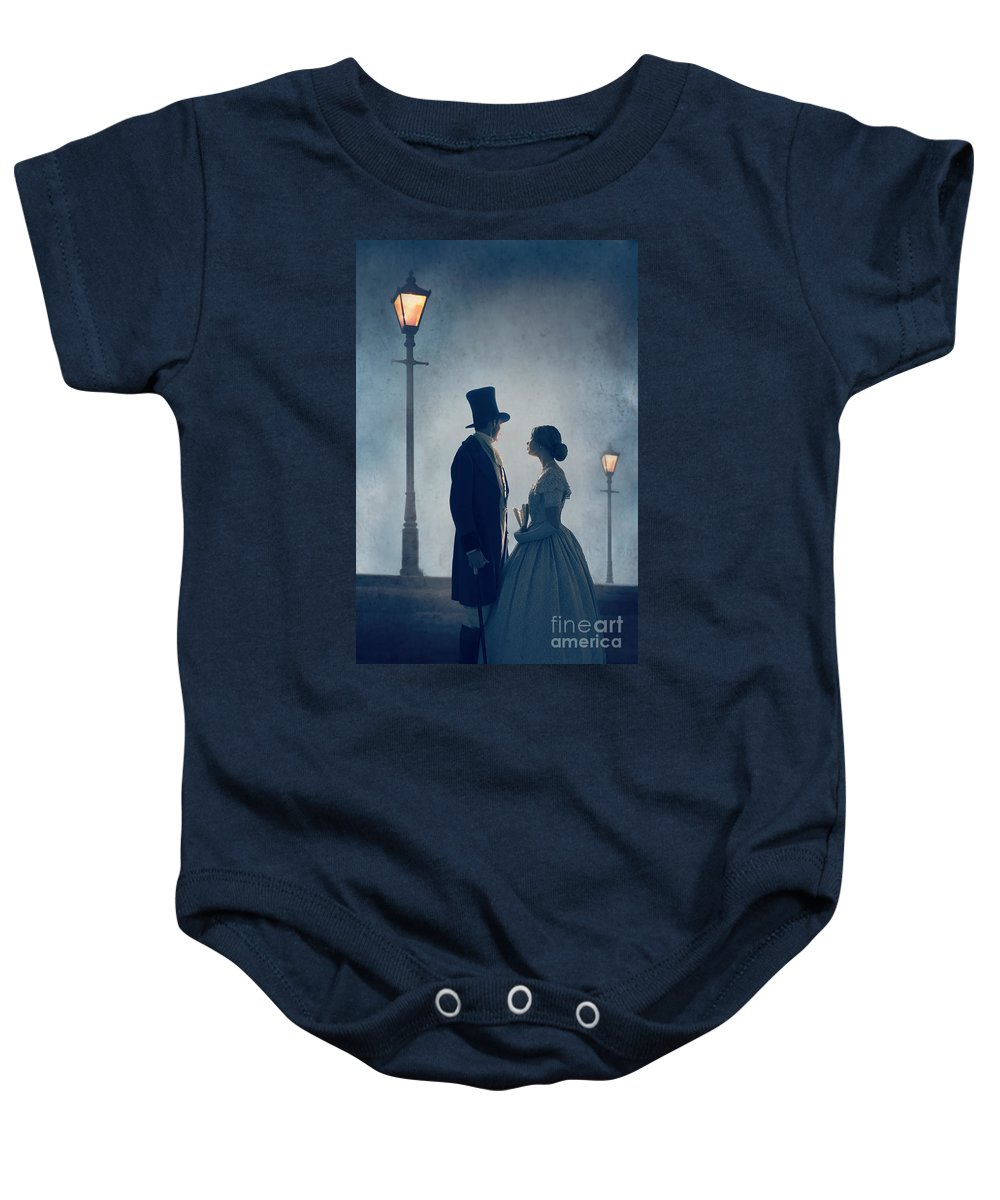 Victorian Baby Onesie featuring the photograph Victorian Couple At Nighttime Under Gas Lights by Lee Avison