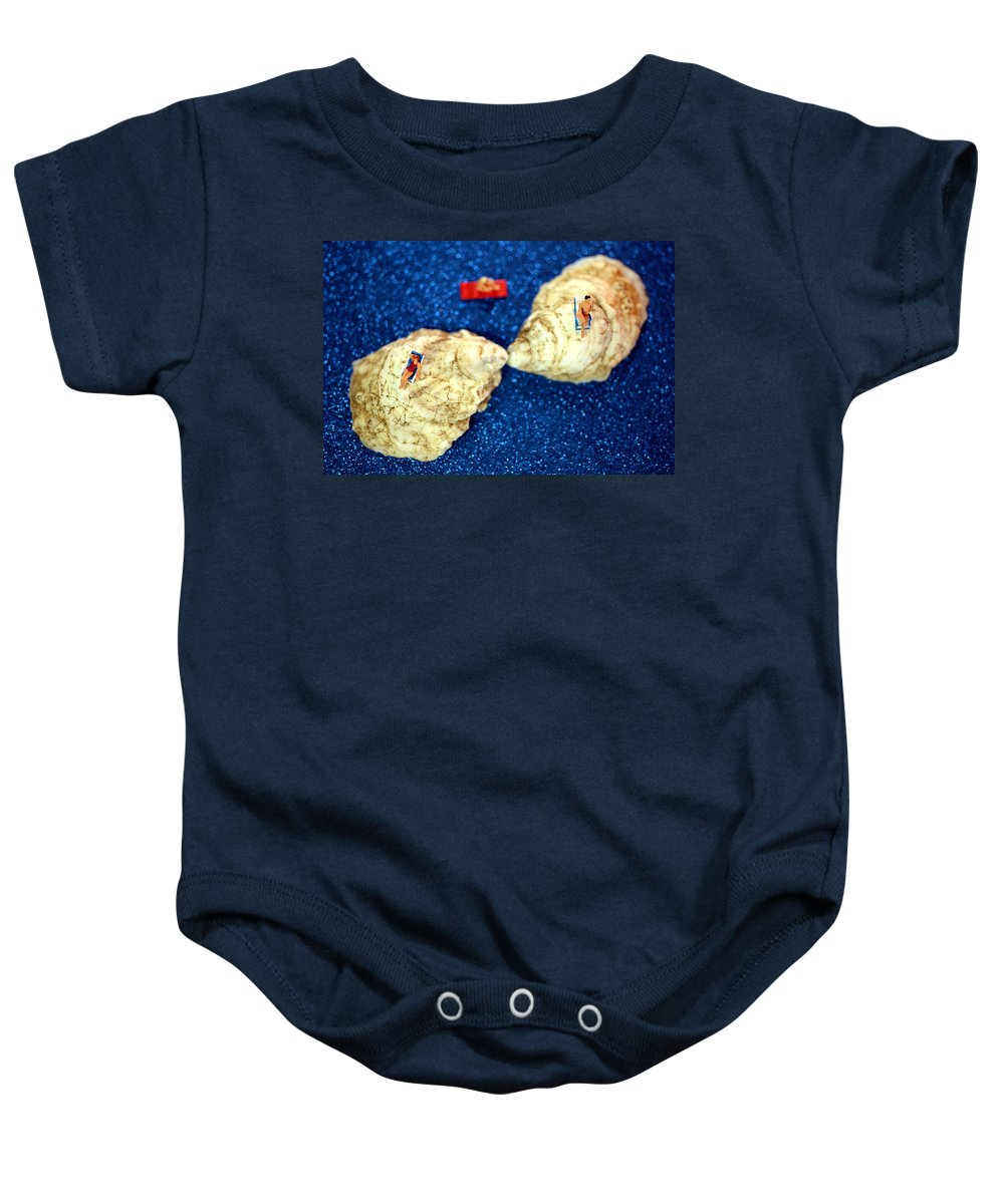 Surreal Baby Onesie featuring the photograph Sunbather On Oyster Shells by Paul Ge