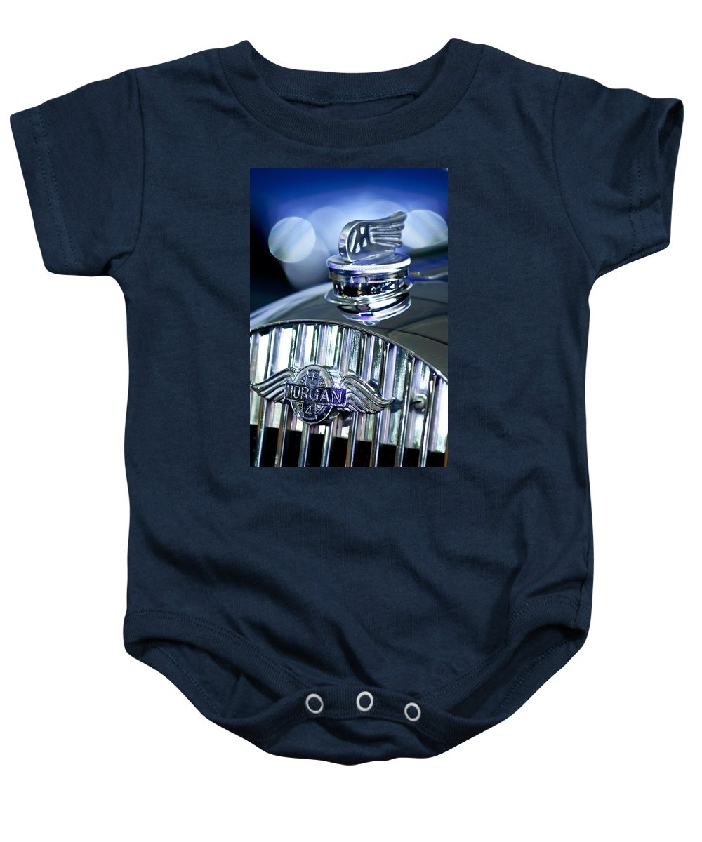 1952 Morgan Plus 4 Baby Onesie featuring the photograph 1952 Morgan Plus 4 Hood Ornament And Emblem by Jill Reger