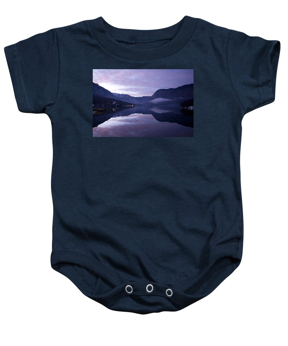 Bohinj Baby Onesie featuring the photograph First Sunset Of The Year by Ian Middleton