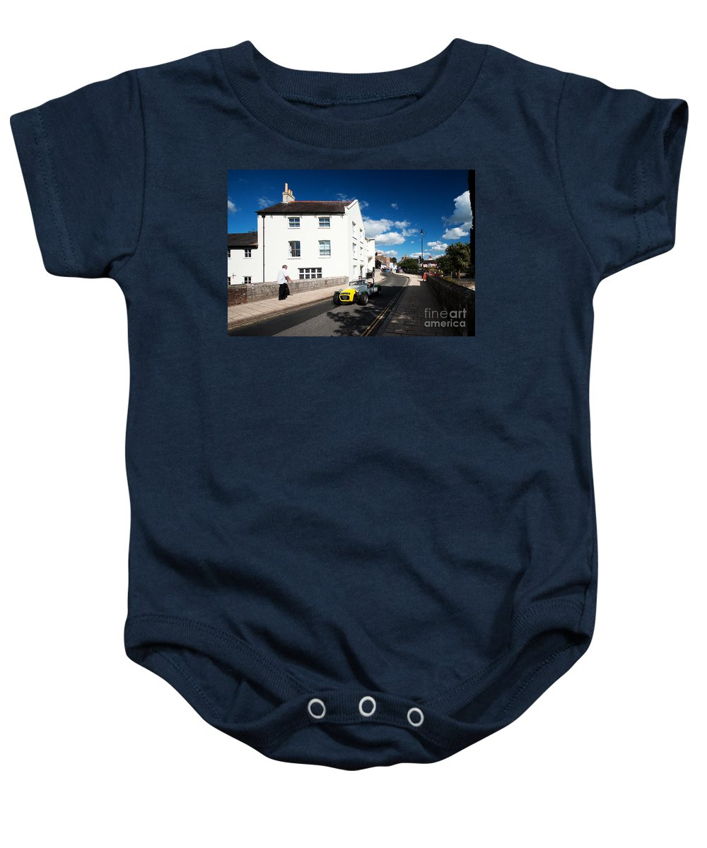 Lotus Baby Onesie featuring the photograph a Lotus in Christchurch by Rob Hawkins