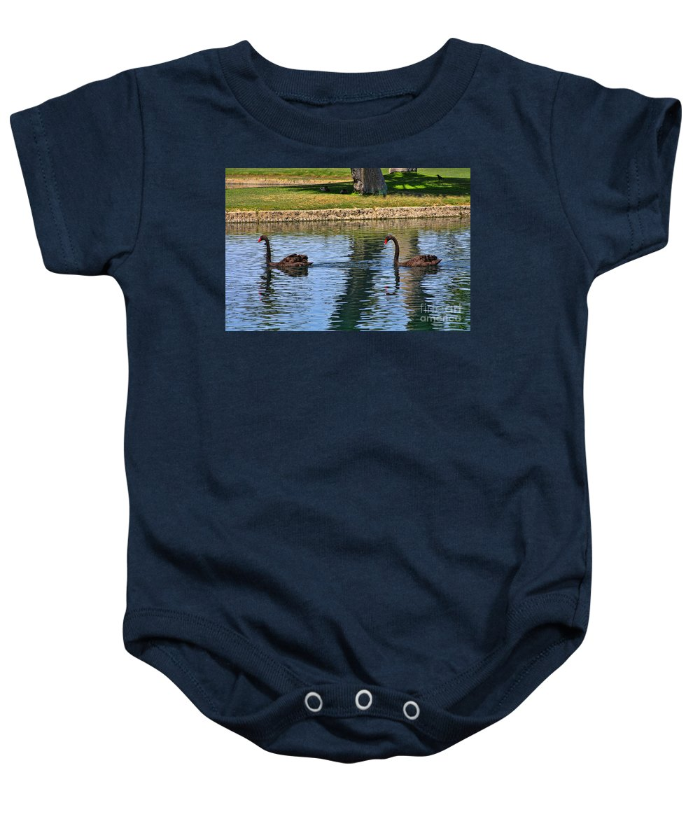 Black Swan Baby Onesie featuring the photograph Black Swan's In Palm Springs by Tommy Anderson