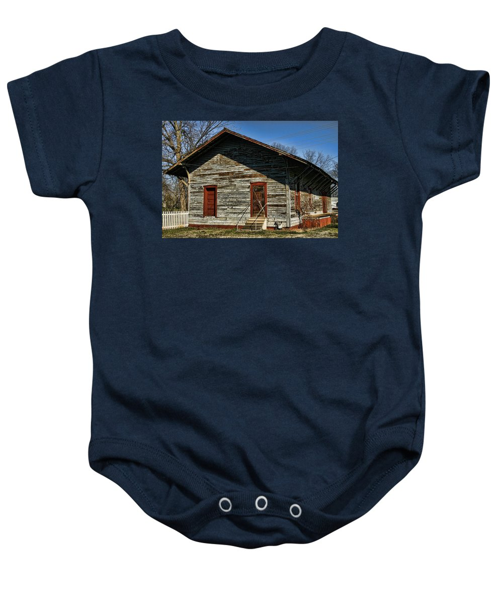 Railroad Baby Onesie featuring the photograph Historic Circa 1800s Railway Station by Kathy Clark