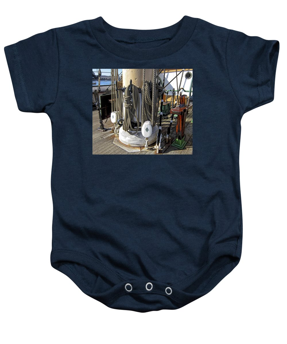Maritime Baby Onesie featuring the photograph Maritime Pulley And Rope Work by Daniel Hagerman