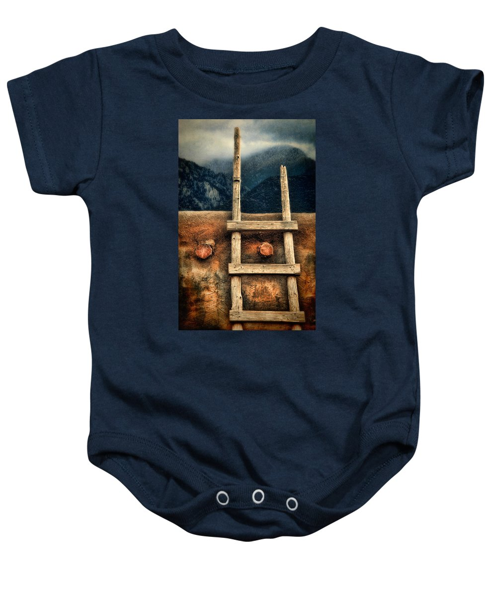 Adobe Baby Onesie featuring the photograph Rustic Ladder On Adobe House by Jill Battaglia
