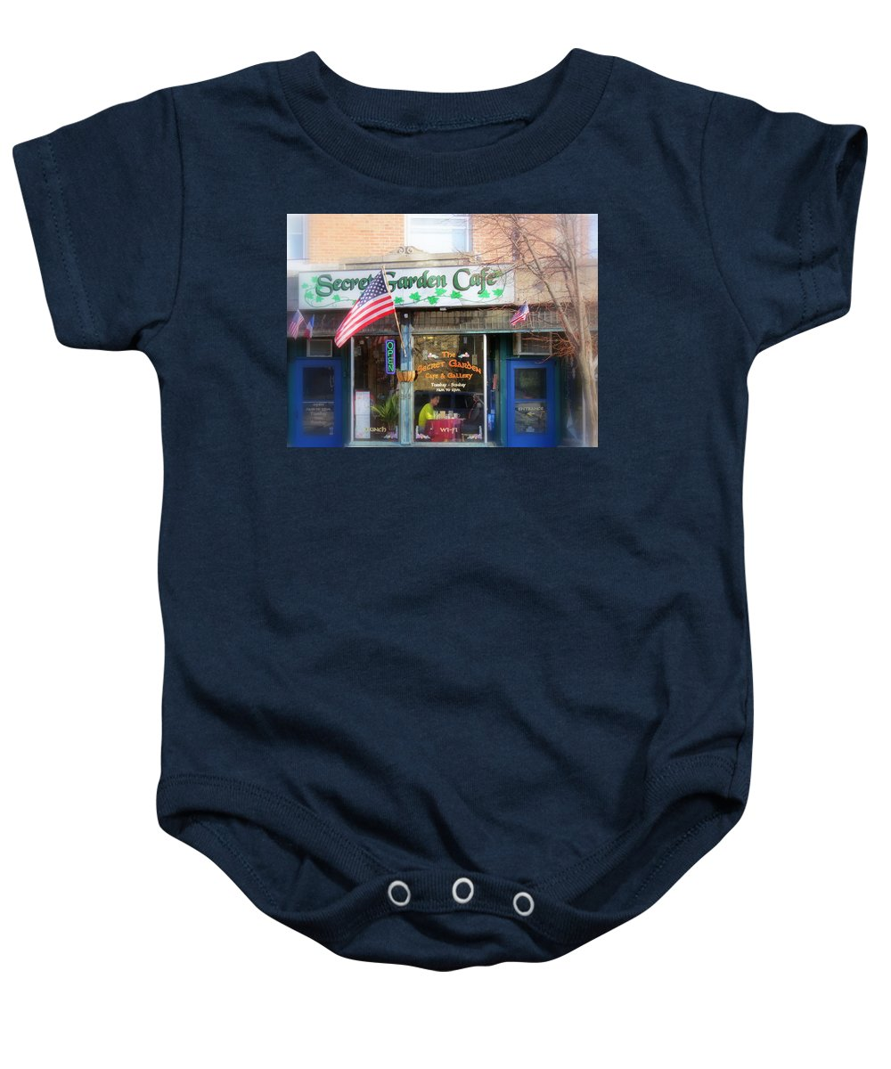 Patriotic Baby Onesie featuring the photograph Secret Garden Cafe by Kay Novy