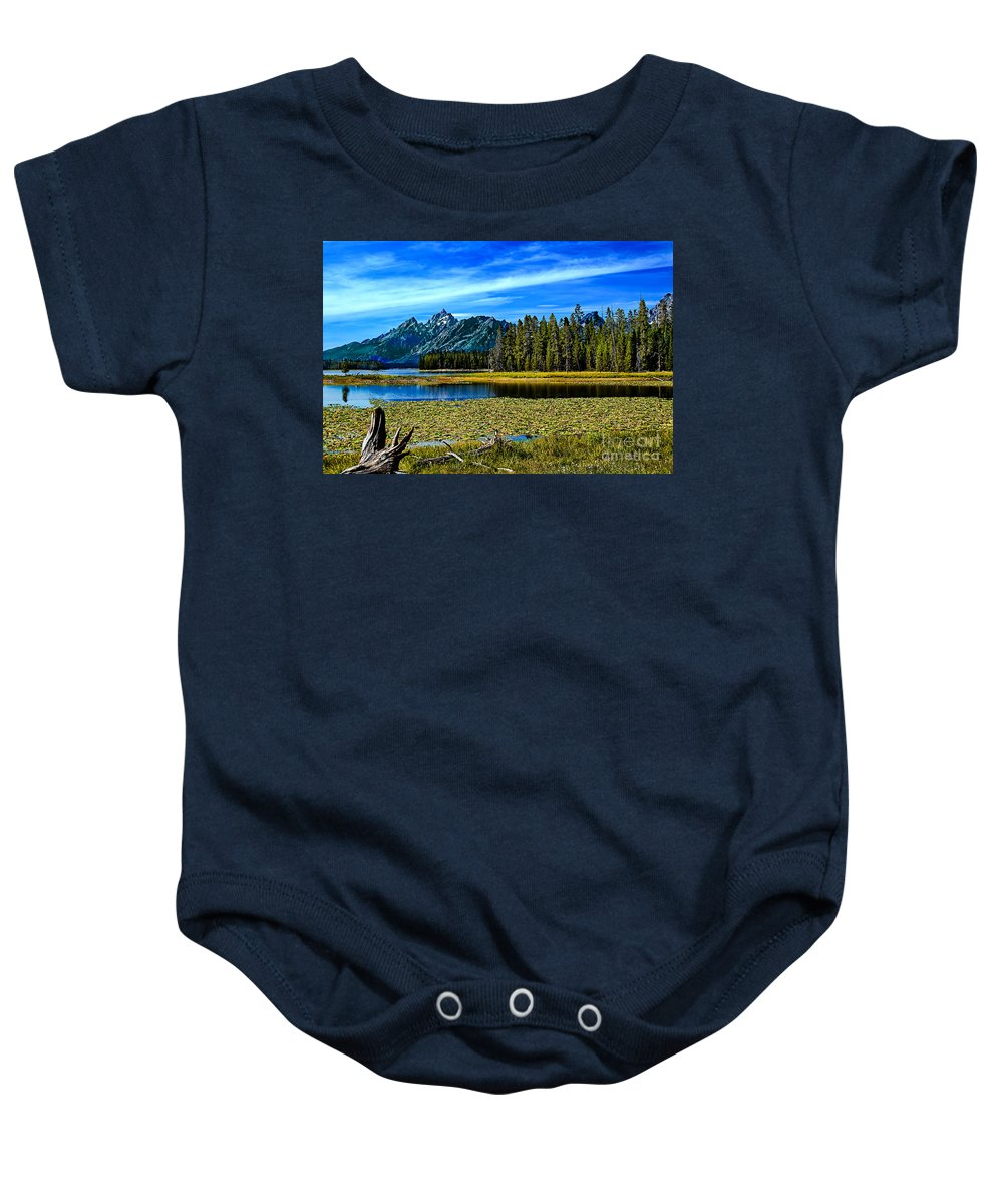 Grand Tetons Baby Onesie featuring the photograph Swan Lake II by Robert Bales