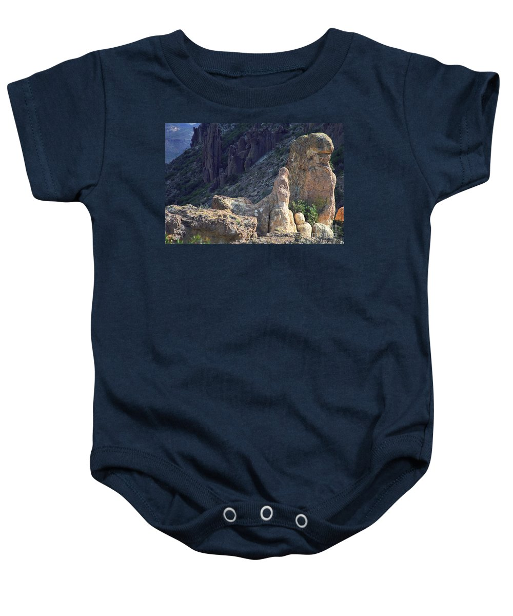 Rock Formations Baby Onesie featuring the photograph A Hard Ride by Kathy McClure