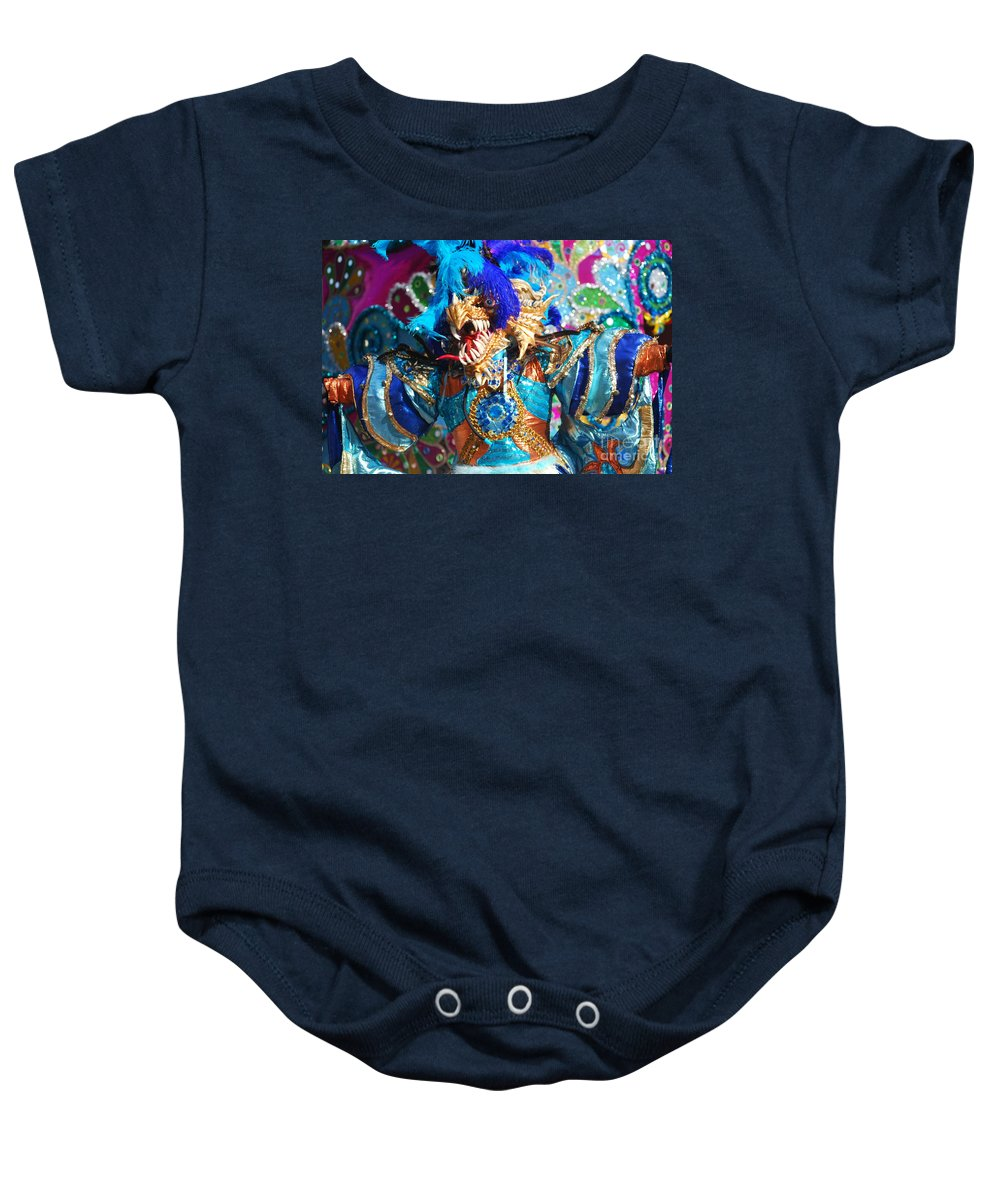 Carnival Baby Onesie featuring the photograph Blue Feather Carnival Costume And Colorful Background Horizontal by Heather Kirk