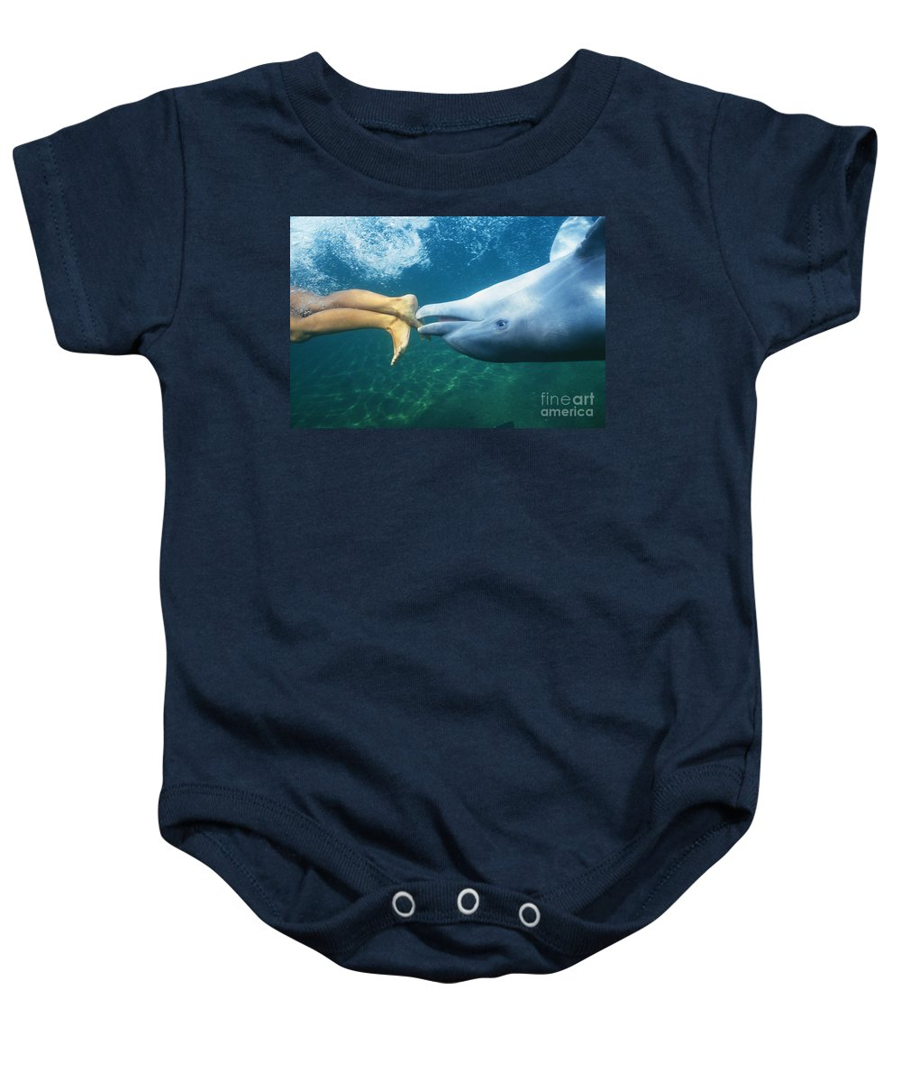 Air Baby Onesie featuring the photograph Bottlenose Dolphin by Bob Abraham - Printscapes