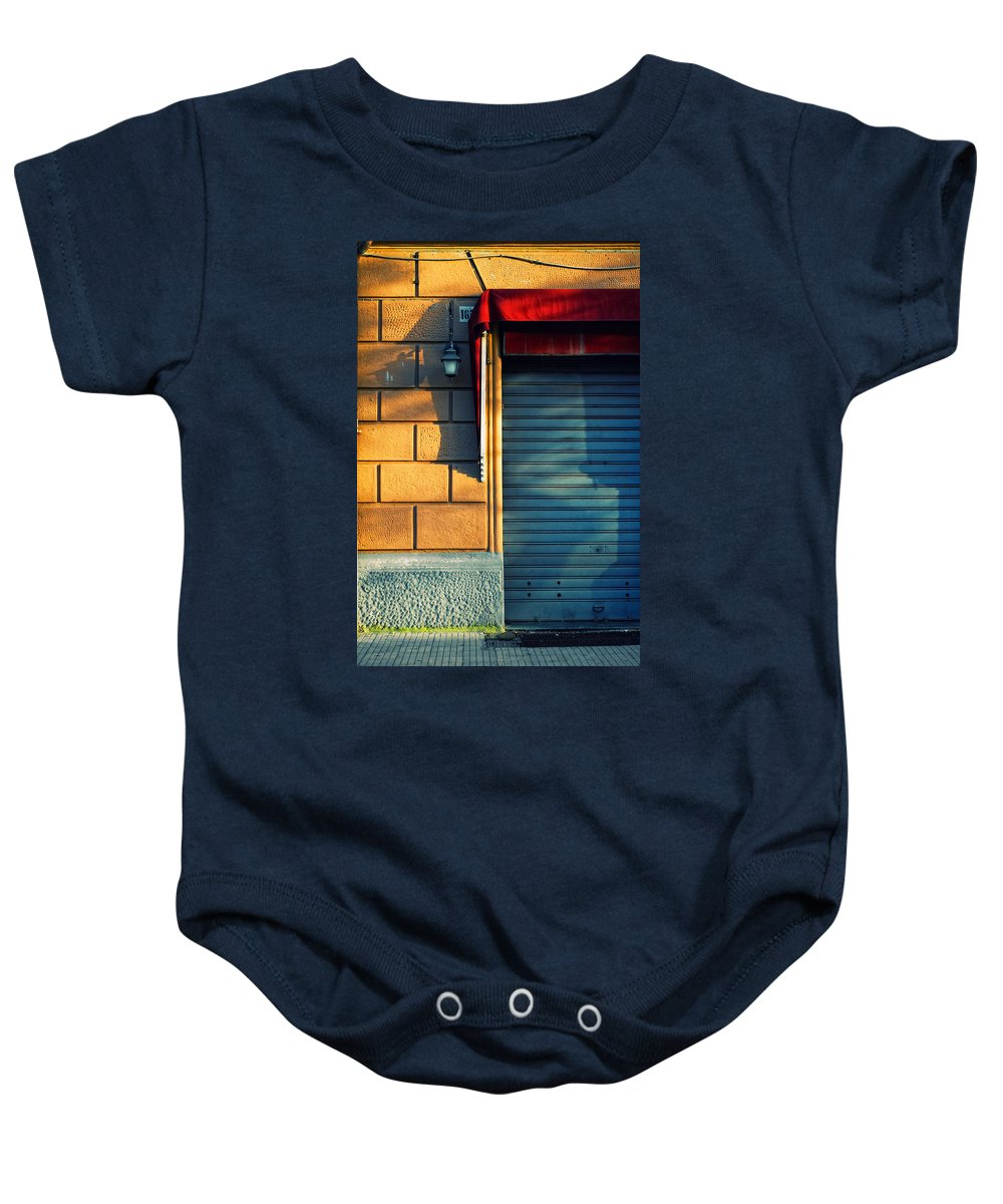 Sunset Baby Onesie featuring the photograph Closed Shop Door At Sunset by Silvia Ganora