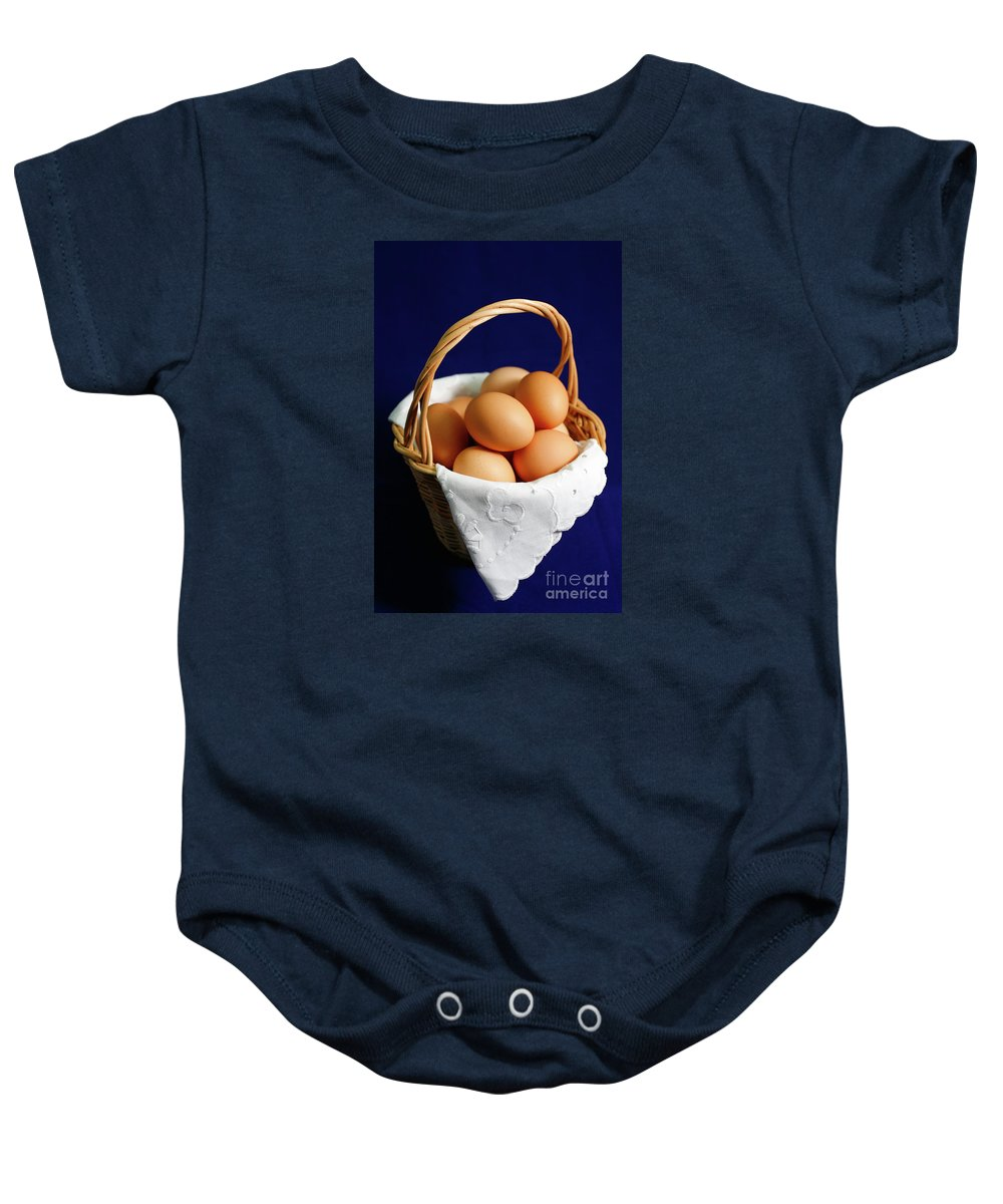 Eggs Baby Onesie featuring the photograph Eggs In A Wicker Basket. by Gaspar Avila