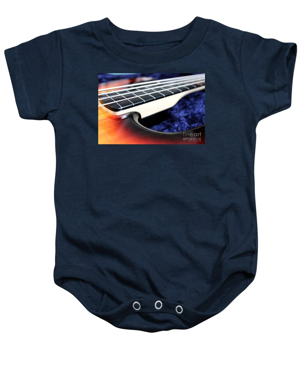 Still Life Baby Onesie featuring the photograph Fretless by Todd Blanchard