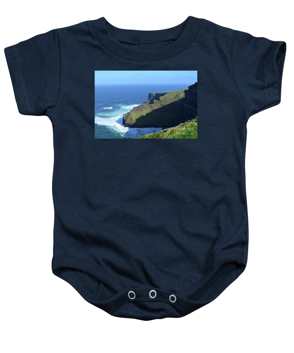 Cliffs-of-moher Baby Onesie featuring the photograph Grass Growing Along The Sea Cliffs In Ireland by DejaVu Designs