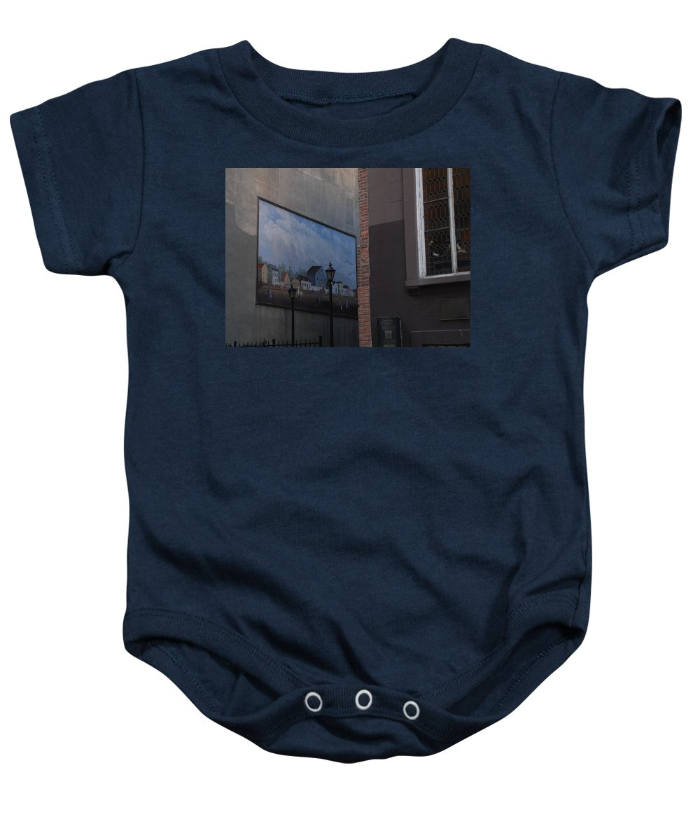 Street Scene Baby Onesie featuring the photograph Hanging Art In N Y C by Rob Hans