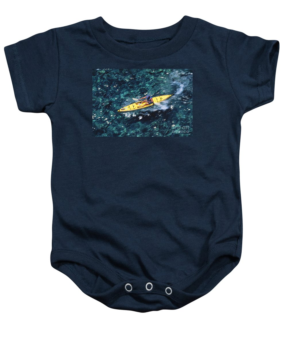 Above Baby Onesie featuring the photograph Kayaker Over Coral Reef by Ron Dahlquist - Printscapes