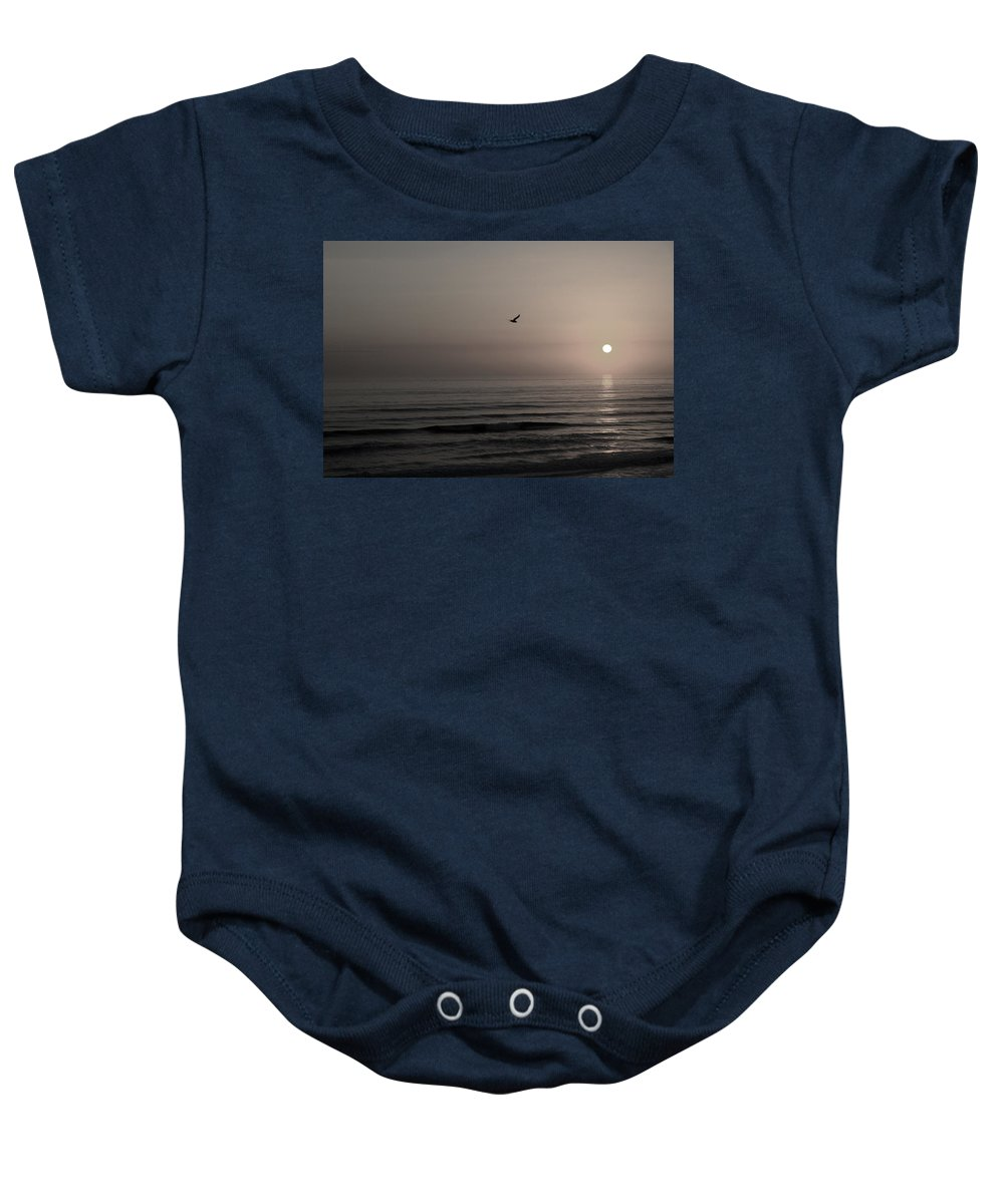 Beach Ocean Wave Sunrise Sunset Sun Bird Gull Fly Flight Water Vacation Peace Nature Relax Peace Baby Onesie featuring the photograph Lonely Flight II by Andrei Shliakhau