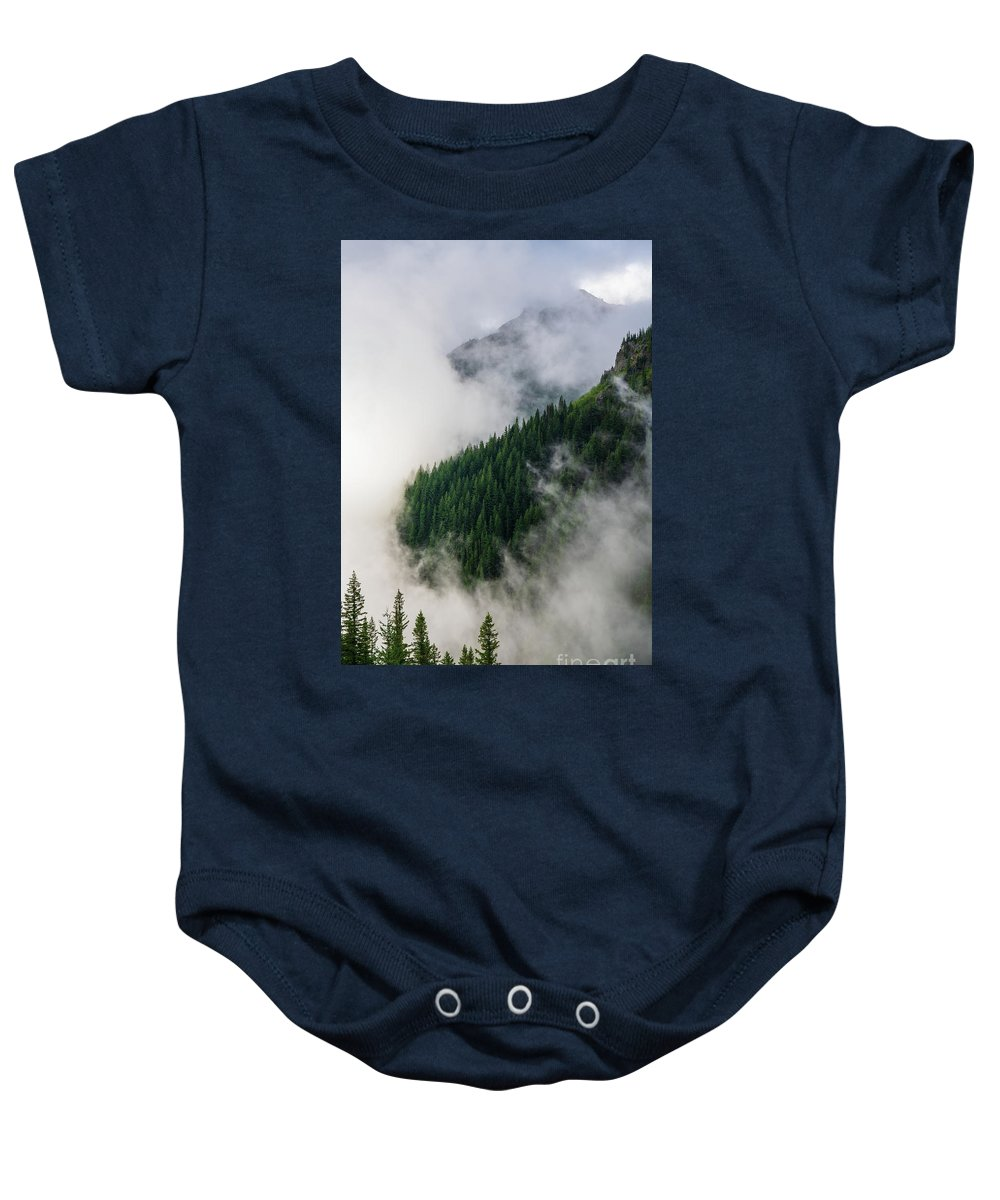 Rainier Baby Onesie featuring the photograph Mount Rainier National Park Clouds And Forest by Mike Reid