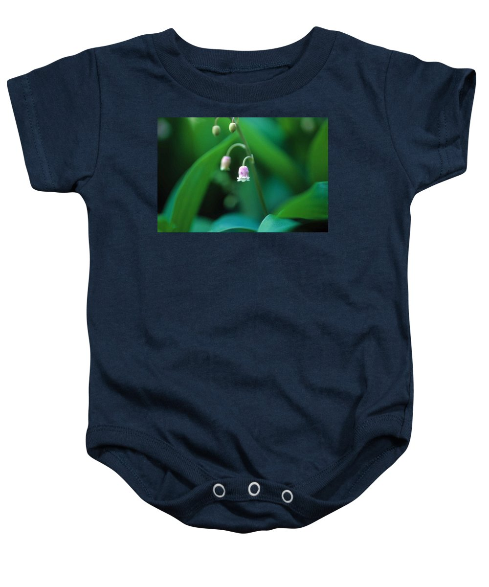 Lilly Of The Valley Baby Onesie featuring the photograph Nurys Lilly by Laurie Paci