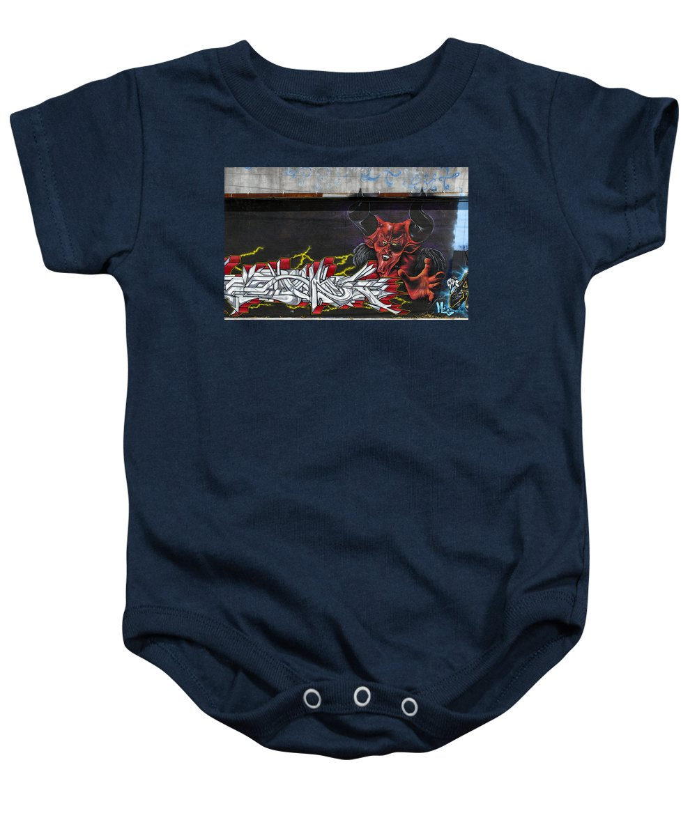 Devil Baby Onesie featuring the photograph Rubrum Diabolus by Keith Armstrong