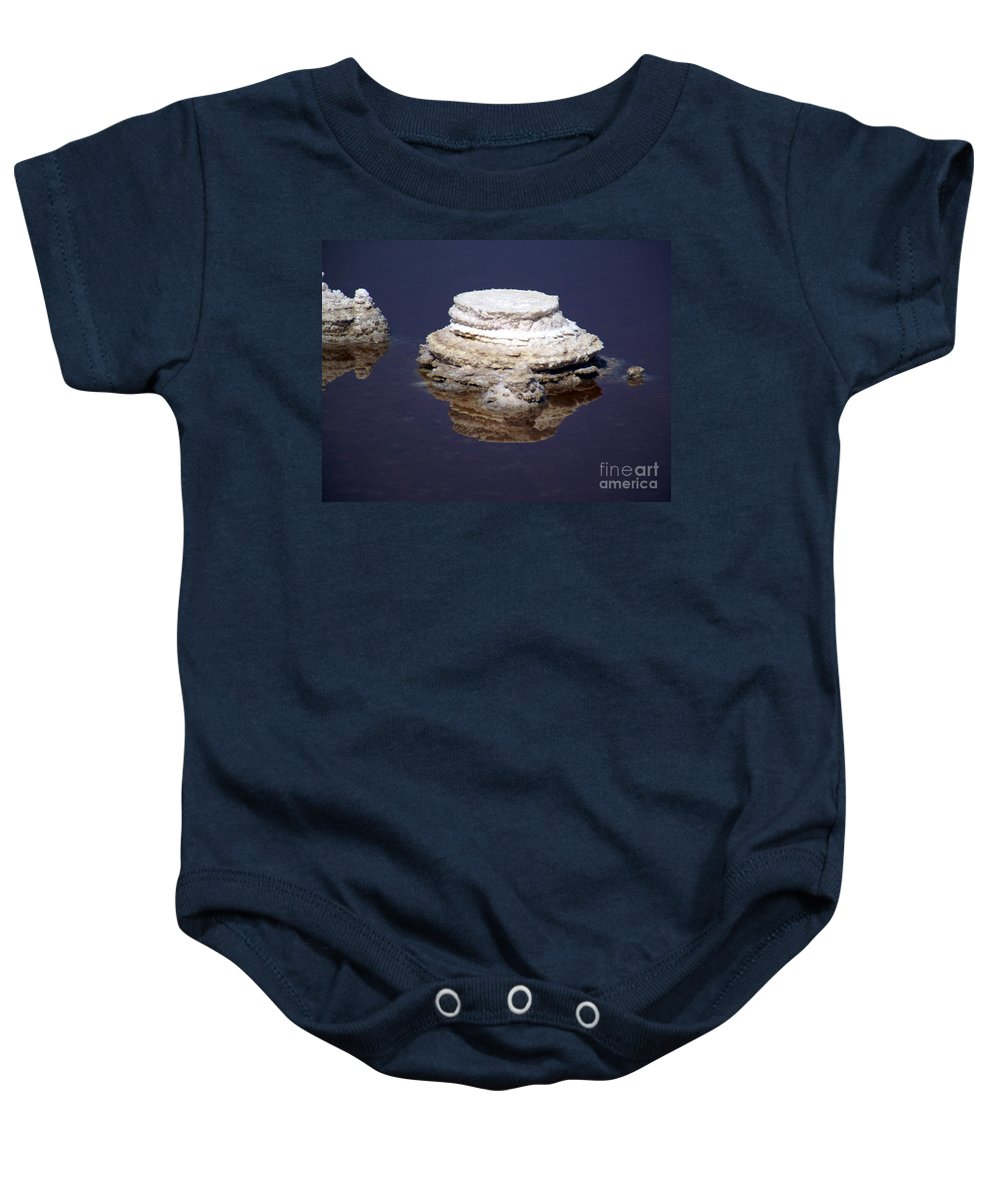 Salt; Formation Baby Onesie featuring the photograph salt cristal at the Dead Sea Israel by Avi Horovitz