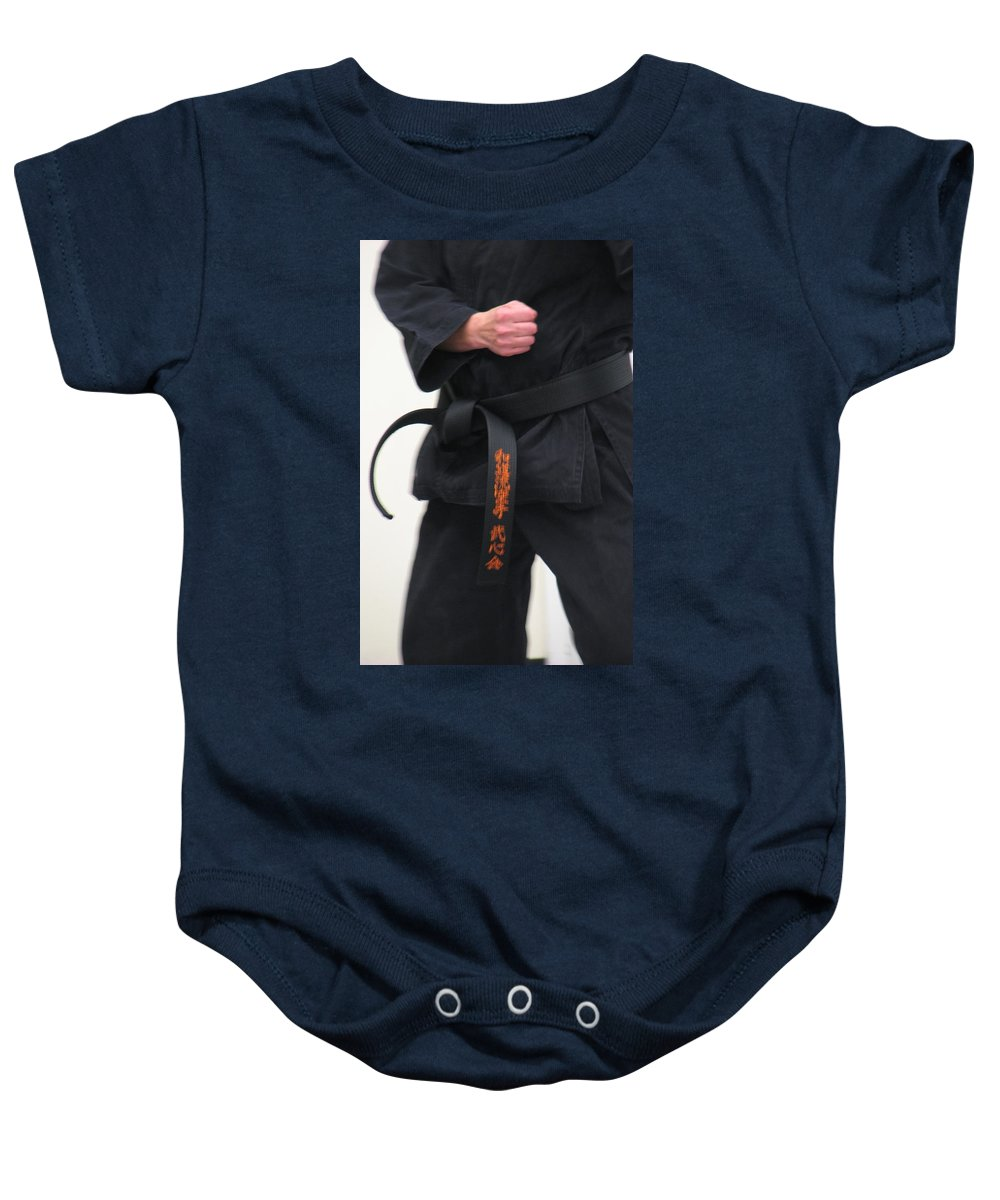Karate Baby Onesie featuring the photograph Stands With Fist by Kelly Mezzapelle