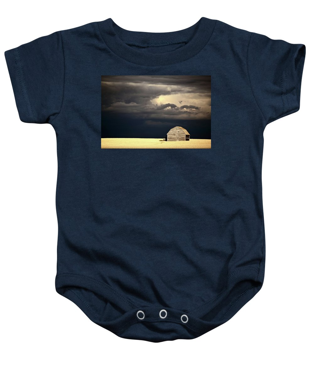 Abandoned Baby Onesie featuring the digital art Storm Clouds Behind Abandoned Saskatchewan Barn by Mark Duffy