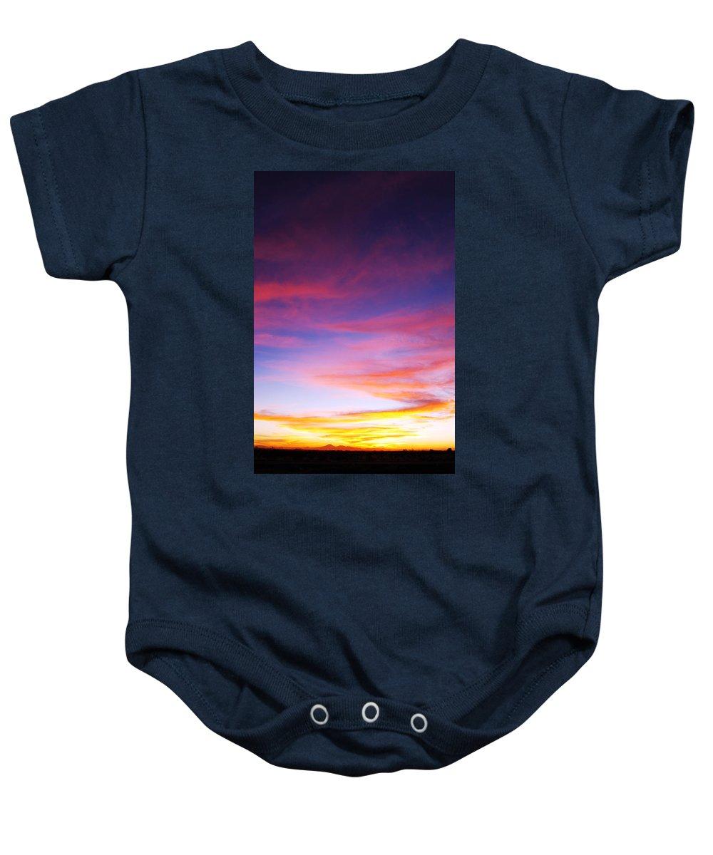 Sunset Baby Onesie featuring the photograph Sunset Over Desert by Jill Reger