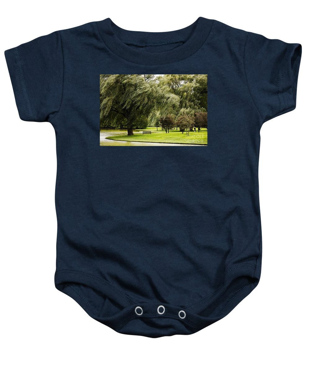 Tree Baby Onesie featuring the photograph Weeping Willow Trees On Windy Day by Carol F Austin