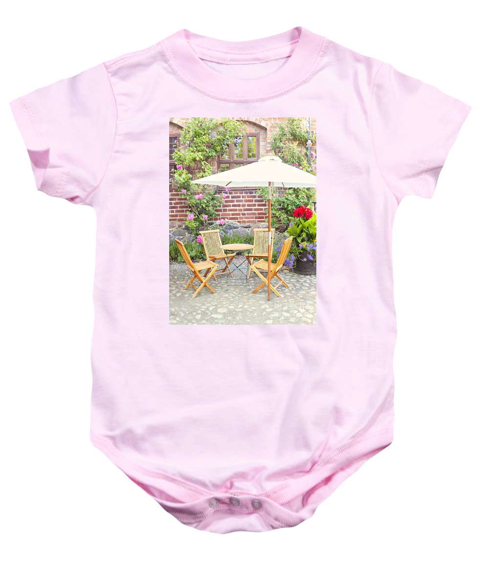 Cobbles Baby Onesie featuring the photograph Garden Seating Area by Sophie McAulay