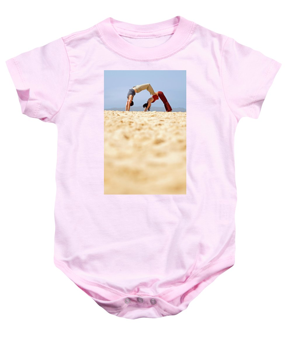 Australia Baby Onesie featuring the photograph A Man And Woman Practicing Yoga by Lars Schneider
