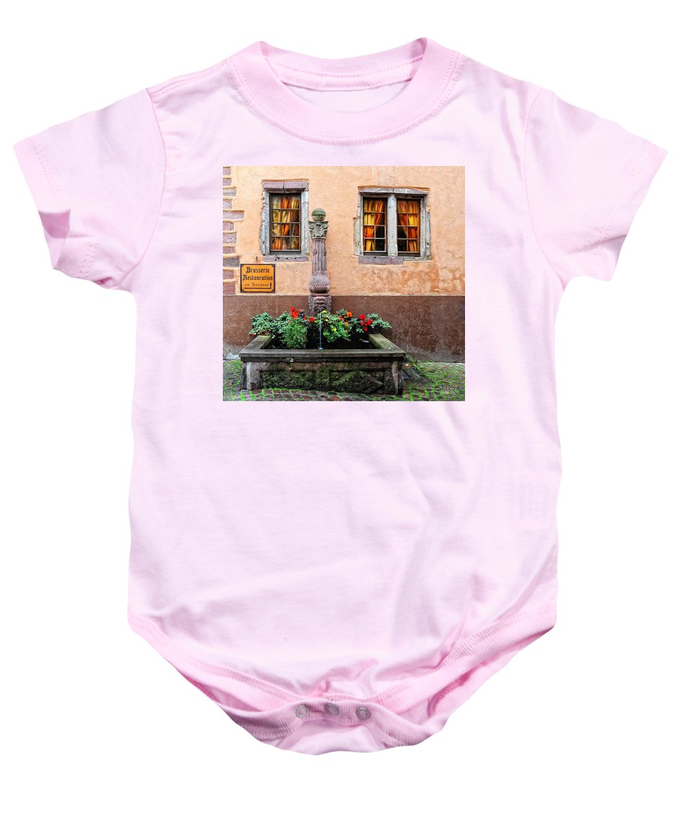 Fountain Baby Onesie featuring the photograph Alsace Fountain by Dave Mills