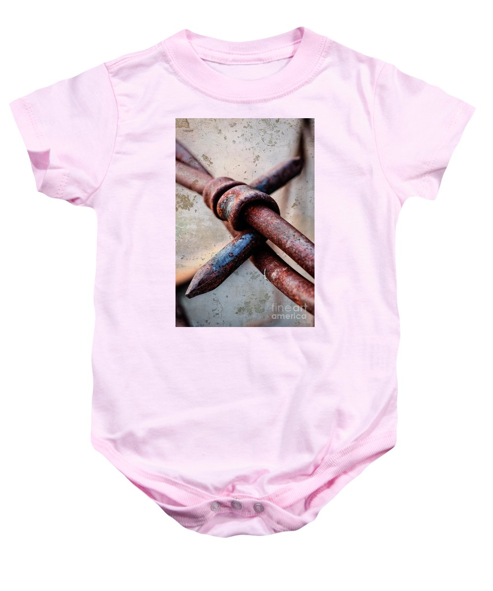 Art Baby Onesie featuring the photograph Barbed Wire by Charles Dobbs