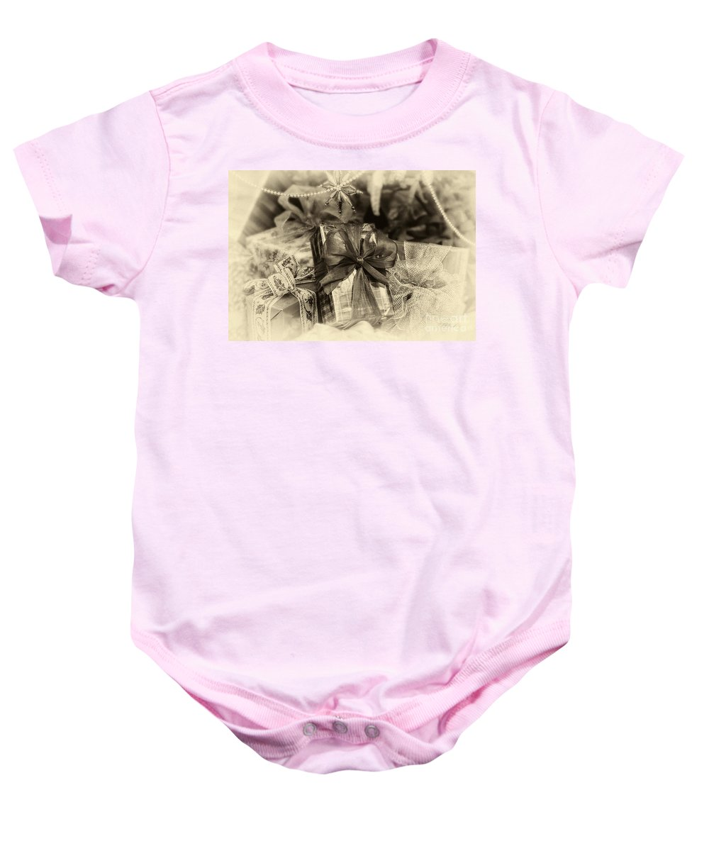 Iris Holzer Richardson Baby Onesie featuring the photograph Christmasgift Under The Tree In Sepia by Iris Richardson