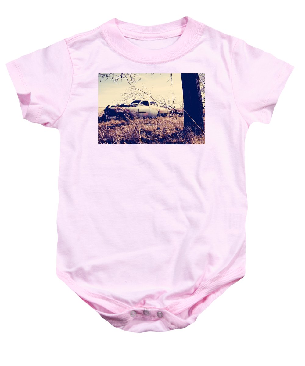 Old Car Baby Onesie featuring the photograph Left Running by The Artist Project