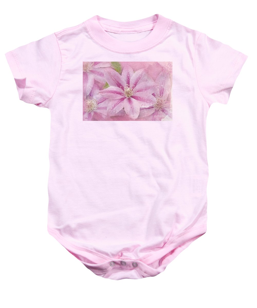 Clematis Baby Onesie featuring the photograph Pink Clematis Profusion by Betty LaRue