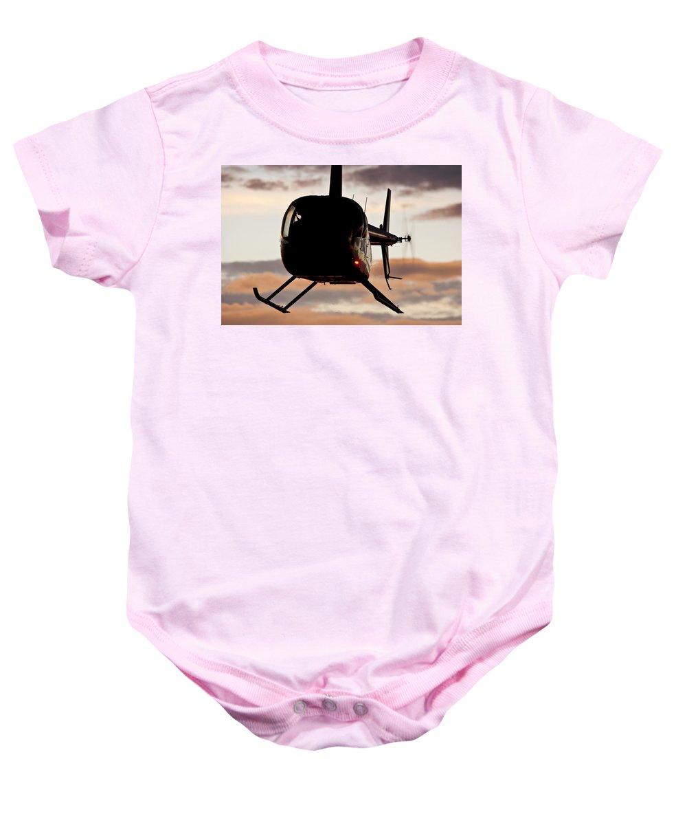 Robinson's R44 Raven 2 Baby Onesie featuring the photograph R44 At Sunset by Paul Job