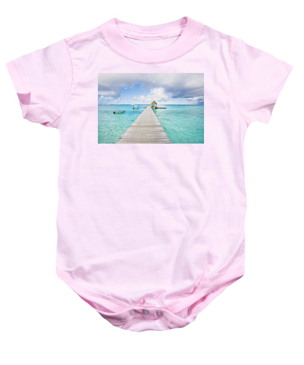 Afternoon Baby Onesie featuring the photograph Rangiroa Atoll Pier On The Ocean by M Swiet Productions