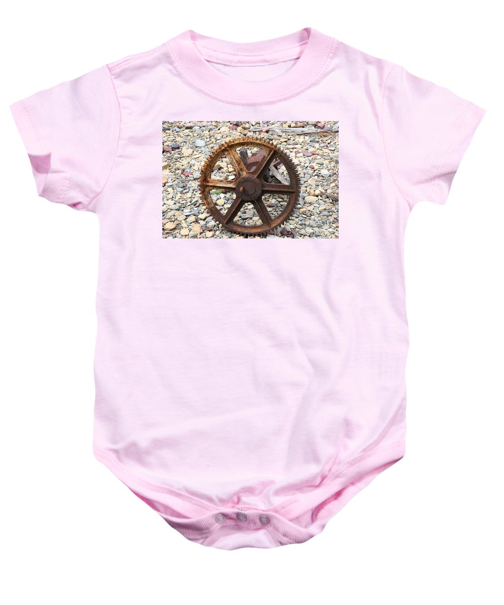 Rusted Baby Onesie featuring the photograph Rusted Gear Wheel Glacier National Park Montana by Jason O Watson